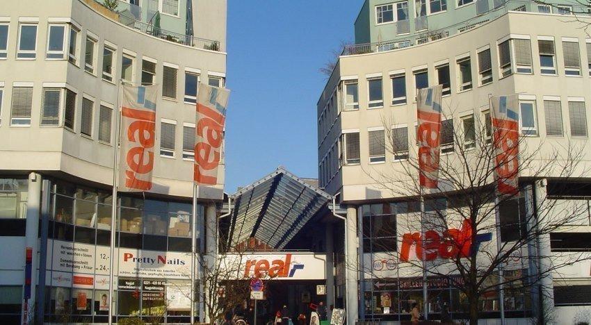 Картинка: Metro продает подразделения гипермаркетов Real за 1 млрд евро
